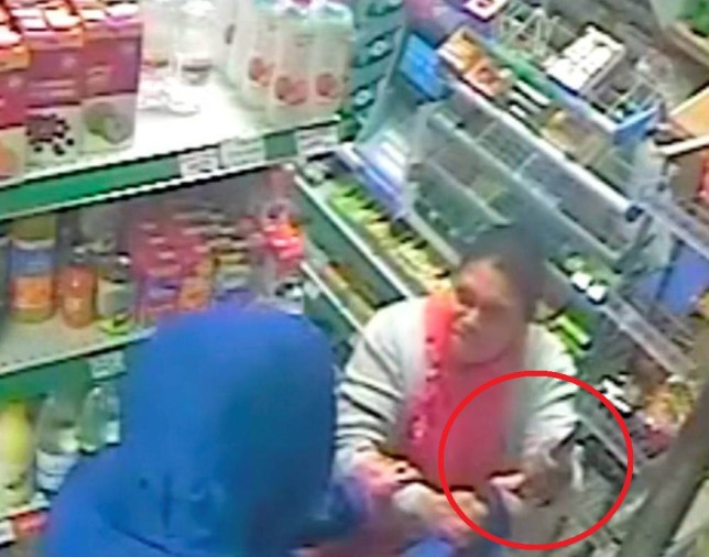 CCTV grab shows the moment that Edward Stevenson robbed Lanhydrock Stores, St Judes. See SWNS copy SWCCTV : This is the heroic moment a defiant female shopkeeper grabbed a knife-wielding robber - and DRAGGED him out of her shop. The brave woman, in her 50s, was working behind the counter when hoodie-wearing Edward Stevenson pulled a blade on her. But instead of handing over cash the shop-owner grabbed him by the hands and dragged him round the store. The victim, who does not wish to be named, pulled him all the way to the door and threw him out before defiantly slamming the door.