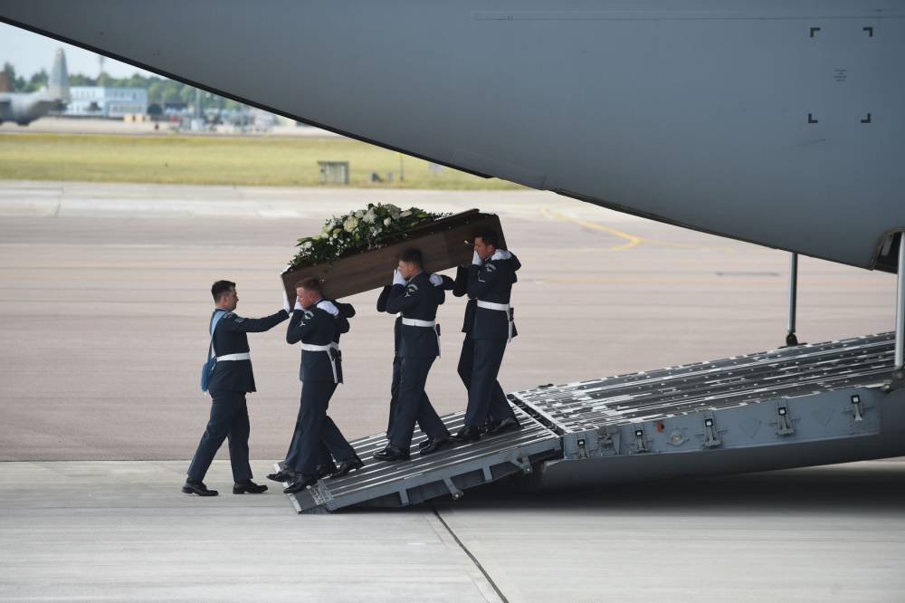 The coffin of Joel Richards is taken from the RAF C-17 carrying the bodies of eight British nationals killed in the Tunisia terror attack at RAF Brize Norton in Oxfordshire. PRESS ASSOCIATION Photo. Picture date: Wednesday July 1, 2015. The bodies of eight Britons killed by the gunman will be returned to the UK today. It comes as the names of two more people who died in the attack emerged, following a statement from their family. The first RAF flights left Britain early this morning and will carry the bodies back to Brize Norton, with the repatriation process expected to take a number of days. See PA story POLICE Tunisia. Photo credit should read: Joe Giddens/PA Wire