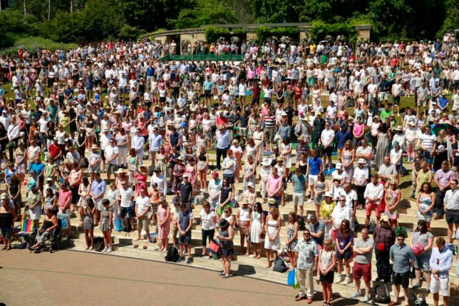 Tennis - Wimbledon - All England Lawn Tennis & Croquet Club, Wimbledon, England - 3/7/15  Spectators observe a national minute's silence for victim's of the attacks in Tunisia a week ago  Mandatory Credit: Action Images / Andrew Couldridge  Livepic  EDITORIAL USE ONLY.