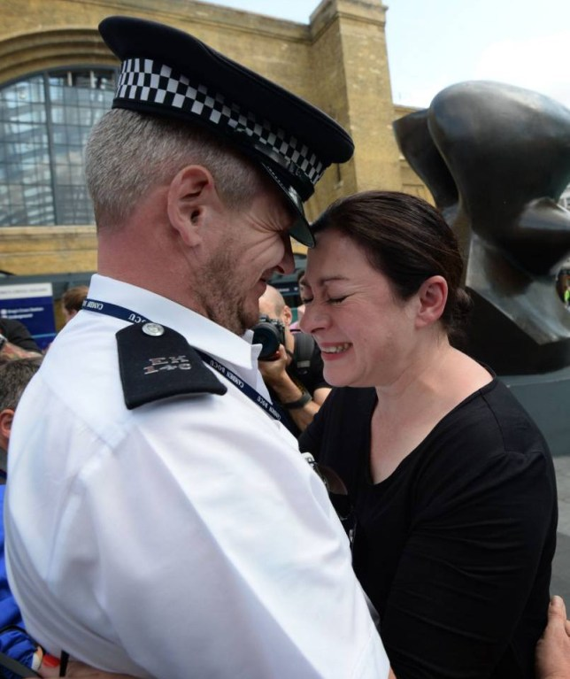 """7/7 survivor Gill Hicks hugs PC Andy Maxwell, who came to her aid when she was injured at Kings Cross Station in London nearly 10 years ago, as Ms Hicks and faith leaders retraced where the devastating 7/7 London bombings took. PRESS ASSOCIATION Photo. Picture date: Monday July 6, 2015. The small procession is part of an initiative calling on people in London to """"walk together"""" on the 7/7 anniversary tomorrow by finishing their morning bus or Underground commute one stop early and walking the last few minutes. See PA story MEMORIAL July7. Photo credit should read: Stefan Rousseau/PA Wire"""