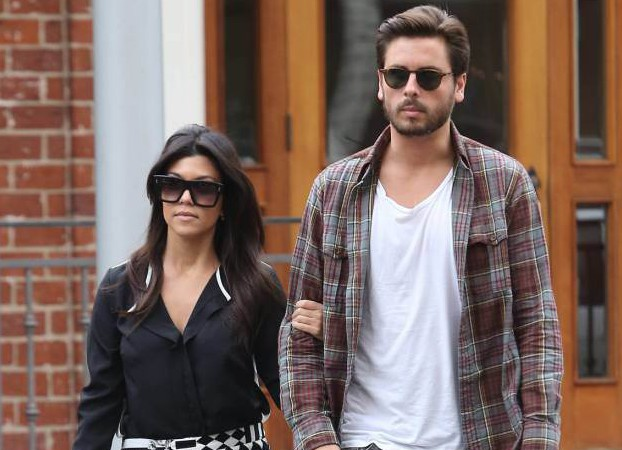 """Reality TV star KOURTNEY KARDASHIAN has reportedly parted ways with her longtime boyfriend SCOTT DISICK. Kim Kardashian's older sister and Disick have been together since 2006 and have three children together. Disick, who is featured on several of the family's reality shows, has publicly struggled with alcohol issues over the past decade and editors at TMZ.com report his sobriety is at the centre of the couple's latest breakup. According to the publication, Disick has not been seen at the couple's family home in Calabasas, California for over a month. A source says, """"His partying lately has made her make this tough decision."""" If the reports are true, they come days after Disick was photographed on vacation in Monte Carlo with stylist Chloe Bartoli and friends. A source tells Eonline.com, """"Kourtney has always taken Scott back and been by his side, but now with three kids it has gotten old. Kourtney has to do what's best for the kids. """"Scott has been running around saying he's single. Kourtney dumped him after she saw the pics (in Monte Carlo) and he hasn't been home after a month-long party binge."""" (KG/WNWCZM&WNWE/KL)** Kourtney Kardashian out and about in West Hollywood with Scott Disick carrying a drink from The Coffee Bean & Tea Leaf Featuring: Kourtney Kardashian, Scott Disick Where: Los Angeles, United States When: 12 Nov 2013 Credit: WENN.com"""