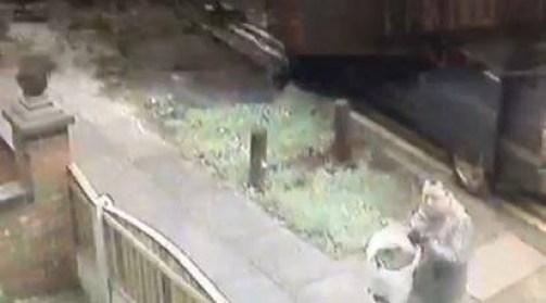 Alan Pilling dumps rats in his neighbour's garden in Skelmersdale, Lancs.