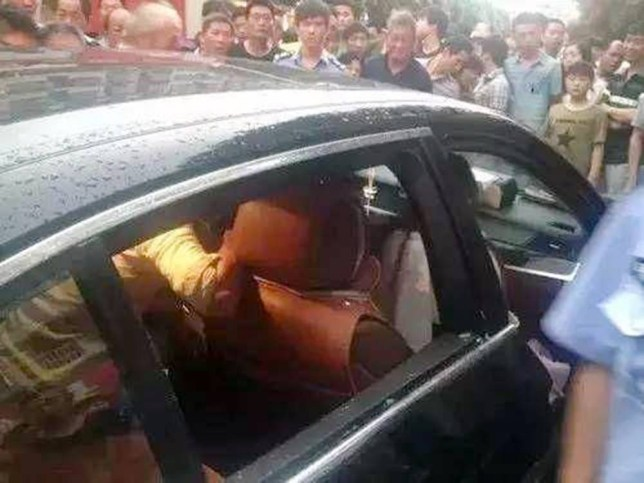 """Pic shows: Emergency services trying to save the son inside the car.nnA woman has incurred the wrath of netizens across the country after she refused to allow firefighters to break her car window to save her trapped son because the vehicle was too expensive.nnAfter her three-year-old son became stranded in the back of her BMW, the unnamed mother from Yiwu city in east China¿s Zhejiang Province stunned onlookers when she told firefighters not to break the car window to rescue the boy.nnReports said the BMW had locked itself, with the mother unable to open the car door.nnThe trapped boy was heard crying inside the hot vehicle and clawing at the window.nnHowever, instead of allowing rescuers to break the glass, the mother said she wanted to wait for a locksmith instead, so as not to damage her expensive car.nnFirefighters finally took the initiative several minutes later when the boy began to faint inside the oxygen-deprived car. They smashed in the window and rescued the boy.nnOne of the firefighter was quoted as saying: """"It¿s very dangerous to leave children inside cars, especially in such heat. It can threaten a child¿s life in a short time.""""nnNetizens took to various social media platforms to criticise the mother, with one netizen saying: """"It looks like the car is her real son.""""nnAnother netizen said: """"The mother shouldn¿t have left her kid in the car in the first place. Even if the car did accidentally lock itself. What happens if someone breaks the window and abducts the kid?""""nn(ends)"""