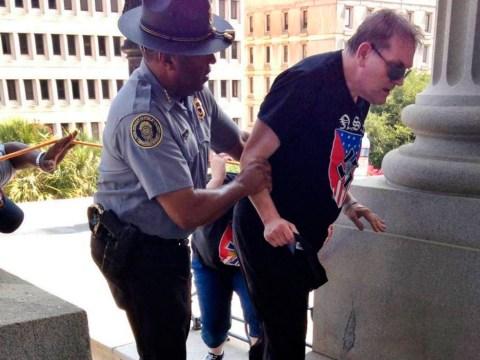 Black officer hopes image of him helping 'KKK member' will lead to something bigger