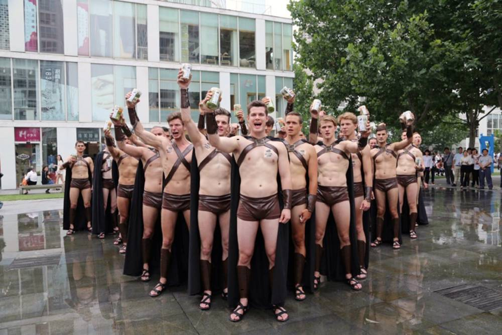 "Pic shows: Some of the men dressed up as Spartan warriors.nnAround 100 male models were arrested by police following a bizarre publicity stunt that involved the men dressing up as Spartan warriors to deliver food.nnThe scantily dressed young guys drew large crowds as they marched through the Chinese capital Beijing  holding boxes of salad as part of a restaurant¿s promotion scheme.nnDressed only in skimpy leather shorts, anklets and capes the group were hired by local restaurant Sweetie Salad to deliver the boxes to office workers. They were also seen standing in ""pyramid formation"" and yelling in front of an office building.nnBut the stunt backfired when police suddenly decided the gathering was a public disturbance and ordered the group to disperse.nnHaving failed to leave after being asked by members of the Beijing Public Security Bureau, the models were later forcibly detained as a permit had not been granted for the gathering beforehand.nnSome police were photographed actually sitting on top of some of the models and handcuffing them as they resisted arrest.nnThe pictures of the incident went viral on social media in China  drawing many negative comments.ntUser Itleel commented: "" Judging from the photos , they were not delivering. 100 people in a pyramid formation was indeed disturbing the normal flow of pedestrian traffic.""nnAnother called Modern Chinese said:"" It is the high time for the Chinese authoritys to put these monkeys in the place they all belong: the Beijing zoo!nn(ends)"