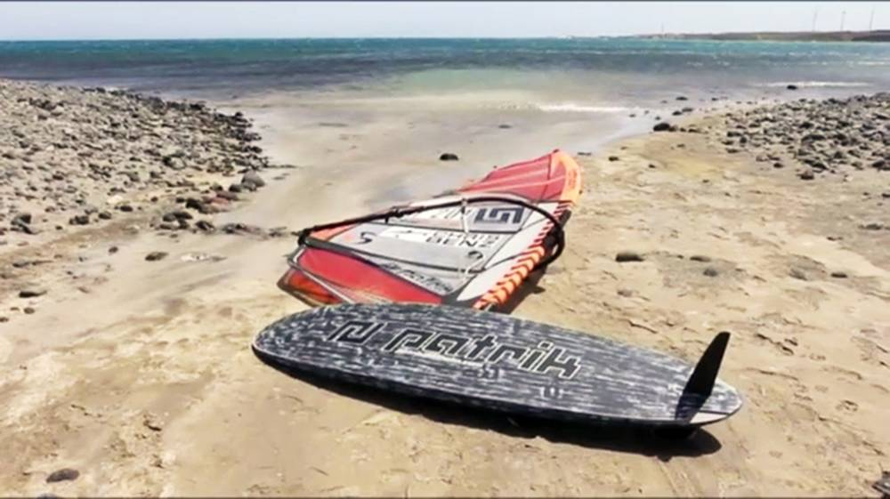 Pic shows: The windsurf board. A Russian snorkeler bled to death after her throat was slashed open when she was hit by a windsurf board just as she emerged from the water. The 31-year-old tourist identified only as Emilia L. was so badly cut that she was almost decapitated after the incident in the waters off the playa de Cueva Laya, Santa LucÌa, Gran Canaria at the south of Spain in the Atlantic Ocean. The woman had been around 80 foot from the shore and was hit by the board being used by a windsurfer just as she came back to the surface. Eyewitnesses said that the windsurfer had been travelling at high speed and video footage of the dead woman's body covered by a sheet on the beach shows that there were strong winds blowing at the time. She had been snorkelling with her partner, a local man, and both were wearing masks with flippers and breathing through a snorkel but neither were carrying a floating buoy to indicate their presence below the water as they looked for fish. The area is also a designated windsurfing and JetSki point and was not normally a place where snorkelling or swimming were allowed. Medics that will cause the same could only confirm the woman had died from blood loss and could not be helped. She was reportedly death even before she was taken from the water. The Swedish windsurfer, aged 41, who was not named, was taken to hospital where he was treated for shock. Council official for security, Nieves GarcÌa, believes that the couple may have accidentally strayed into the sports area while swimming as the sailing zone is not cordoned off by buoys, although it is clearly signposted from the beach. Witnesses on the beach, however, said that the woman Emilia had made her presence known to the windsurfer on at least two occasions and had signalled to him that she was in the water, which was only waist deep. The incident however is being treated as an unfortunate accident and police are not pressing any charges. The windsurfer who was not named was repo