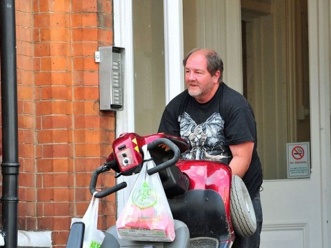 Disabled man receiving £1.3k benefits is caught carrying 17-stone scooter up steps