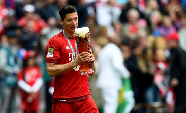 MUNICH, GERMANY - MAY 23: Robert Lewandowski of Muenchen celebrates after winning the league after the Bundesliga match between FC Bayern Muenchen and 1. FSV Mainz at Allianz Arena on May 23, 2015 in Munich, Germany.  (Photo by Lars Baron/Bongarts/Getty Images)