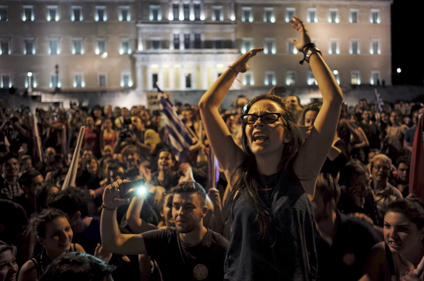 """No"" supporters shout slogans during celebrations following a referendum in front of the parliament in Athens (Picture: Reuters)"