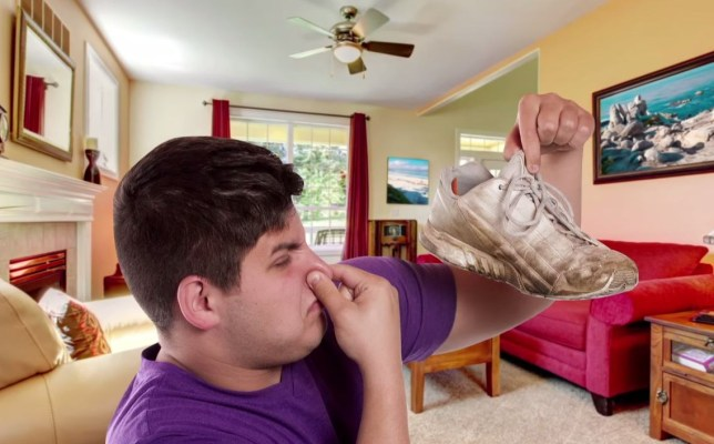 A man holding up a smelly trainer