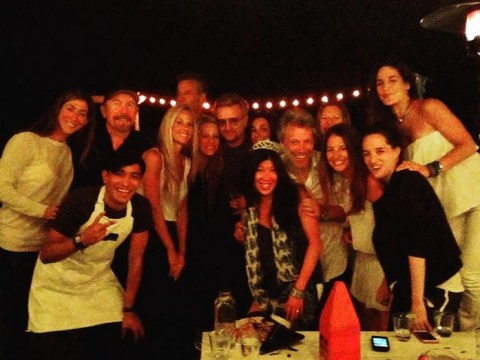 Who needs strippers? U2 and Jon Bon Jovi crash girl's hen party and look like they're loving life