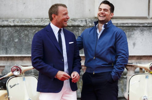 "LONDON, ENGLAND - AUGUST 07:  Guy Ritchie and Henry Cavill attend the people's premiere of ""The Man From U.N.C.L.E"" during Film4 Summer Screenings at Somerset House on August 7, 2015 in London, England.  (Photo by Tristan Fewings/Getty Images)"