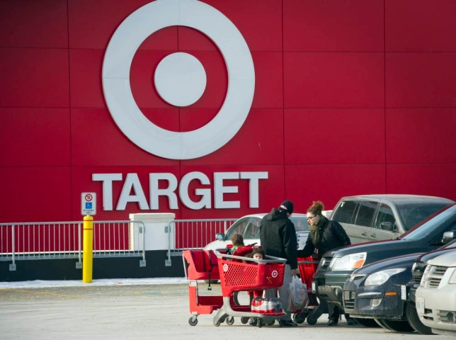 Shoppers unload a shopping cart after exiting a Target Corp. store in Toronto, Ontario, Canada, on Thursday, Jan. 15, 2015. Target Corp. will walk away from Canada less than two years after opening stores there, putting an end to a mismanaged expansion that racked up billions in losses. Photographer: Kevin Van Paassen/Bloomberg via Getty Images