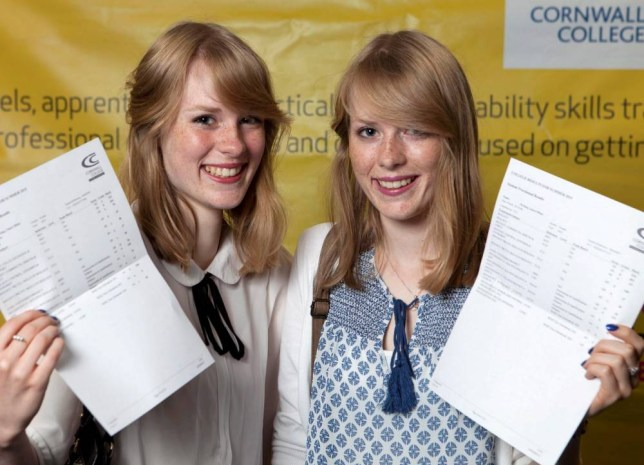 Brainy twins Claire and Laura Newing pick up their A Level results. See SWNS story SWTWINS: Two identical twin sisters got the EXACT same A Level results yesterday (Thurs) - and will now be studying the SAME course at the SAME university. Brainy Claire and Laura Newing, 18, both got A grades in psychology and sociology and a B in biology. The pair have both got places at the University of St Mark & St John in Plymouth where they will both study speech and language therapy. The twins from St Austell, Cornwall, are also following in the footsteps of their big sister - who studied the same course at the same institution.