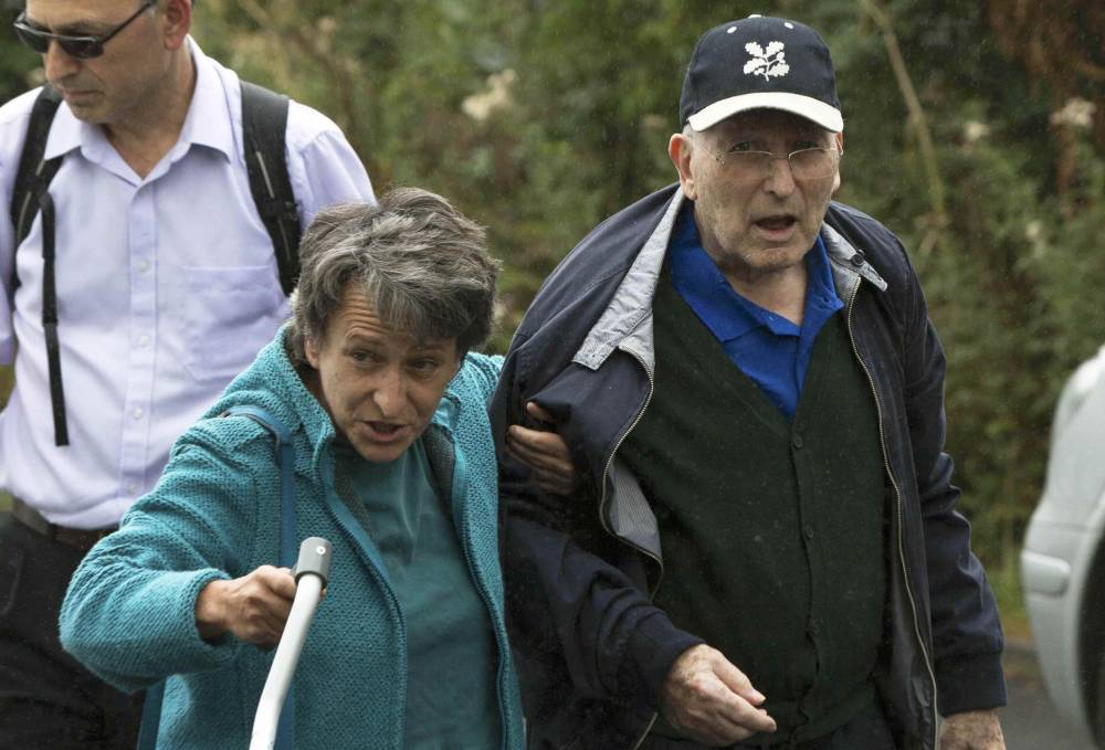 Lord Greville Janner arrives with his daughter Marion at a house after appearing at Westminster Magistrates' Court in London, Britain August 14, 2015. An aging and infirm member of Britain's House of Lords finally appeared in court on Friday over historical child sex abuse allegations, despite his lawyers repeatedly arguing he was too ill to attend. Janner, 87, a former Labor member of parliament and ex-president of the Board of Deputies of British Jews, is accused of 22 offenses in the 1960s, 70s and 80s. He denies the charges. REUTERS/Neil Hall
