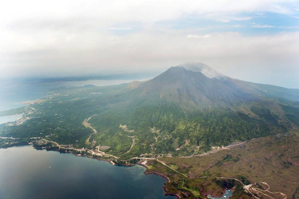 An aerial view shows Mt. Sakurajima in Kagoshima, southwestern Japan, in this photo taken by Kyodo August 15, 2015. Japan warned on Saturday that the volcano, 50 km (31 miles) from a just-restarted nuclear reactor, is showing signs of increased activity, and said nearby residents should prepare to evacuate. Sakurajima, a mountain on the southern island of Kyushu, is one of Japan's most active volcanoes and erupts almost constantly. But a larger than usual eruption could be in the offing, an official at the Japan Meteorological Agency said. Mandatory credit REUTERS/Kyodo ATTENTION EDITORS - FOR EDITORIAL USE ONLY. NOT FOR SALE FOR MARKETING OR ADVERTISING CAMPAIGNS. THIS IMAGE HAS BEEN SUPPLIED BY A THIRD PARTY. IT IS DISTRIBUTED, EXACTLY AS RECEIVED BY REUTERS, AS A SERVICE TO CLIENTS. MANDATORY CREDIT. JAPAN OUT. NO COMMERCIAL OR EDITORIAL SALES IN JAPAN.