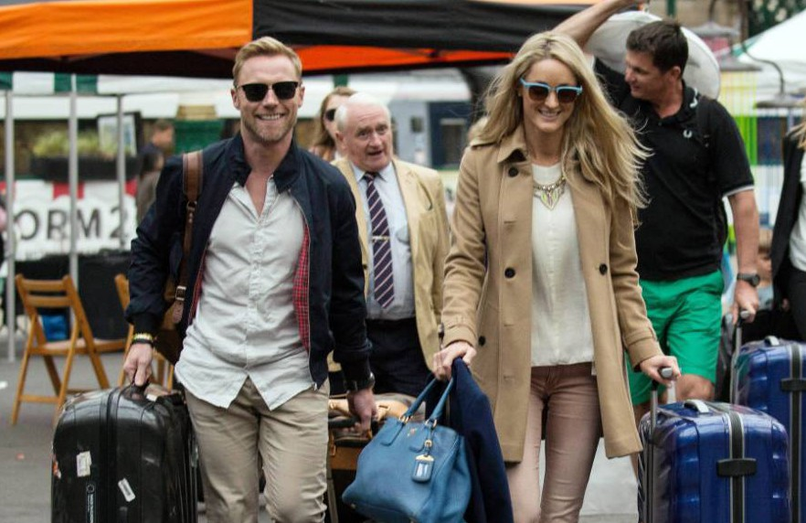 Mandatory Credit: Photo by Alan Simpson/REX Shutterstock (4965035b) Ronan Keating and Storm Uechtritz Ronan Keating and Storm Uechtritz at Waverley Station, Edinburgh, Scotland, Britain - 14 Aug 2015 Ronan Keating arrives at Waverley Station ahead of his wedding on Monday to Storm Uechtritz