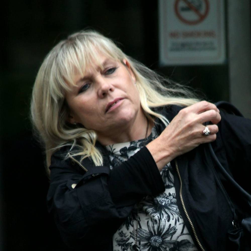 Court snatch of Vivian Archer, 54, up for drink driving over a crash in which a motorcyclist died. A mum died of multiple organ failure after falling over a KITTEN, an inquest was told. See SWNS story SWFALL;  Much-loved Vivian Archer, 55, fractured multiple ribs after tripping over the pet at her home and later died of pneumonia, a coroner heard. Vivian, of Warlingham, Surrey, made several trips to East Surrey Hospital, in Redhill, in the days between the fall and her death after suffering from chest pain brought about as a result of the tumble. But the healthcare assistant was found unconscious by her husband Graham after her condition worsened and she died in the same hospital. Tragic Vivian had a history of depression and alcohol abuse and was on anti-depressant Citalopram, Woking Coronerís Court heart on August 6.