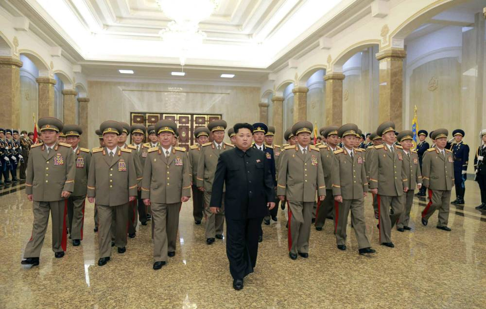epa04890937 (FILE) A file picture released by the Rodong Sinmun, the newspaper of the ruling North Korean Workers Party, shows North Korean leader Kim Jong-un (C) arriving at the Kumsusan Palace of the Sun in Pyongyang, North Korea, 15 April 2015. North Korea has put front-line troops on full combat readiness against the South, a media report said on 21 August 2015, amid escalation of tensions between the rival nations. EPA/RODONG SINMUN SOUTH KOREA OUT