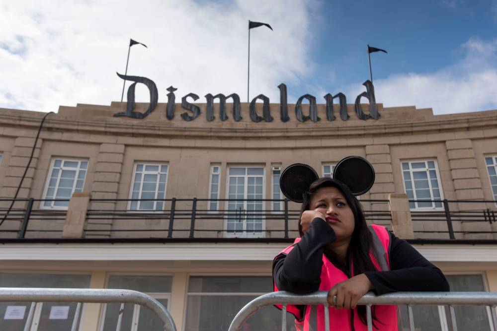 WESTON-SUPER-MARE, ENGLAND - AUGUST 20: A steward is seen outside Banksy's 'Dismaland' exhibition, which opens tomorrow, at a derelict seafront lido on August 20, 2015 in Weston-Super-Mare, England. The show is Banskys first in the UK since the Banksy v Bristol Museum show in 2009 and will be open for 5 weeks at the Topicana site. (Photo by Matthew Horwood/Getty Images)