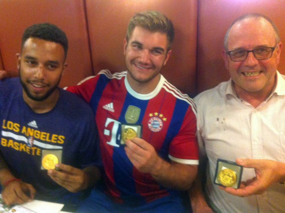 (From L) Anthony Sadler, from Pittsburg, California, Alek Skarlatos from Roseburg, Oregon, and British national Chris Norman who is living in France, hold their medals as they sit in a restaurant after a brief ceremony in the town of Arras, northern France, on August 21, 2015. The American servicemen overpowered a gunman armed with a Kalashnikov who opened fire on a high-speed train travelling from Amsterdam to Paris on August 20, 2015. AFP PHOTO / STRINGER-/AFP/Getty Images