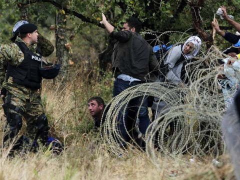 Chaotic footage shows desperate migrants breaking into Macedonia