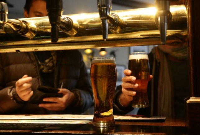 File photo dated 18/04/2014 of customers collecting their drinks in a pub, as a study has shown that there is no cure for a hangover. PRESS ASSOCIATION Photo. Issue date: Saturday August 29, 2015. That is the conclusion of scientists who conducted an in-depth study of morning-after experts - university students. See PA story HEALTH Hangover. Photo credit should read: Yui Mok/PA Wire
