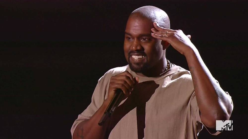 30 August 2015 - Los Angeles - USA **** STRICTLY NOT AVAILABLE FOR USA *** Kanye West announces he will run for President in 2020 during his MTV VMA acceptance speech. Kanye took to the stage, with sweaty armpits, to accept the MTV Video Vanguard Award, which was presented to him by Taylor Swift. The rapper rambled on for 20 minutes after accepting the award and at one point admitted he had smoked a joint before coming out on stage. He ended his speech by announcing he plans to run for the White Hosue in 2020 - and while Swift looked stunned, Kanye's wife Kim Kardashian and her family clapped and cheered the star as he returned to his seat. XPOSURE PHOTOS DOES NOT CLAIM ANY COPYRIGHT OR LICENSE IN THE ATTACHED MATERIAL. ANY DOWNLOADING FEES CHARGED BY XPOSURE ARE FOR XPOSURE'S SERVICES ONLY, AND DO NOT, NOR ARE THEY INTENDED TO, CONVEY TO THE USER ANY COPYRIGHT OR LICENSE IN THE MATERIAL. BY PUBLISHING THIS MATERIAL , THE USER EXPRESSLY AGREES TO INDEMNIFY AND TO HOLD XPOSURE HARMLESS FROM ANY CLAIMS, DEMANDS, OR CAUSES OF ACTION ARISING OUT OF OR CONNECTED IN ANY WAY WITH USER'S PUBLICATION OF THE MATERIAL. BYLINE MUST READ : MTV/XPOSUREPHOTOS.COM PLEASE CREDIT AS PER BYLINE *UK CLIENTS MUST CALL PRIOR TO TV OR ONLINE USAGE PLEASE TELEPHONE 44 208 344 2007