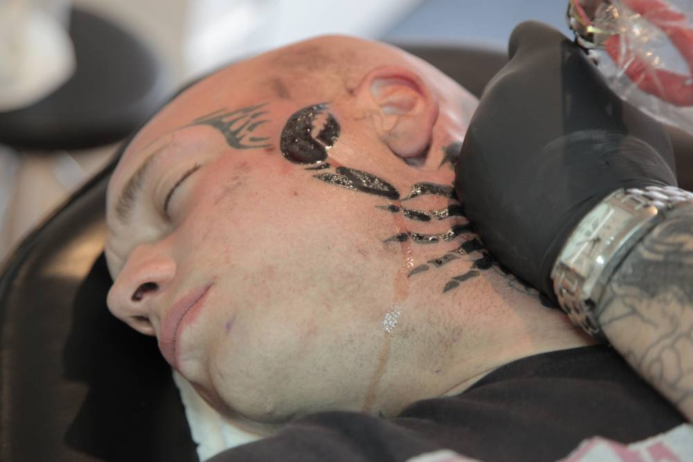 Television Programme: My Tattoo Addiction with Austin Scott.  Oz (Austin Scott), 25, having a scorpion tattoo on his neck to cover an ex girlfriend's name