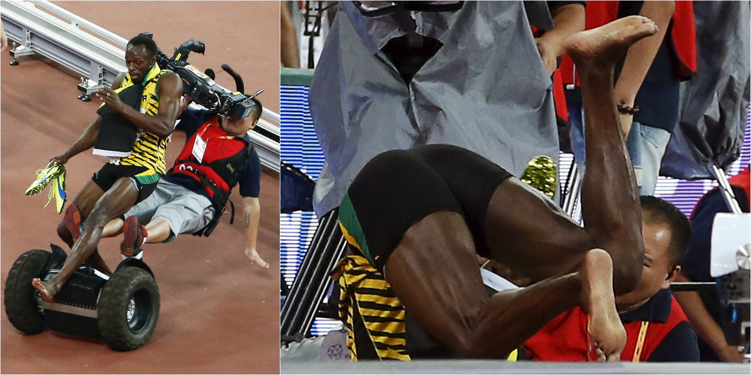 Usain Bolt gets taken out by rogue cameraman on segway after winning 200m gold at Beijing 2015