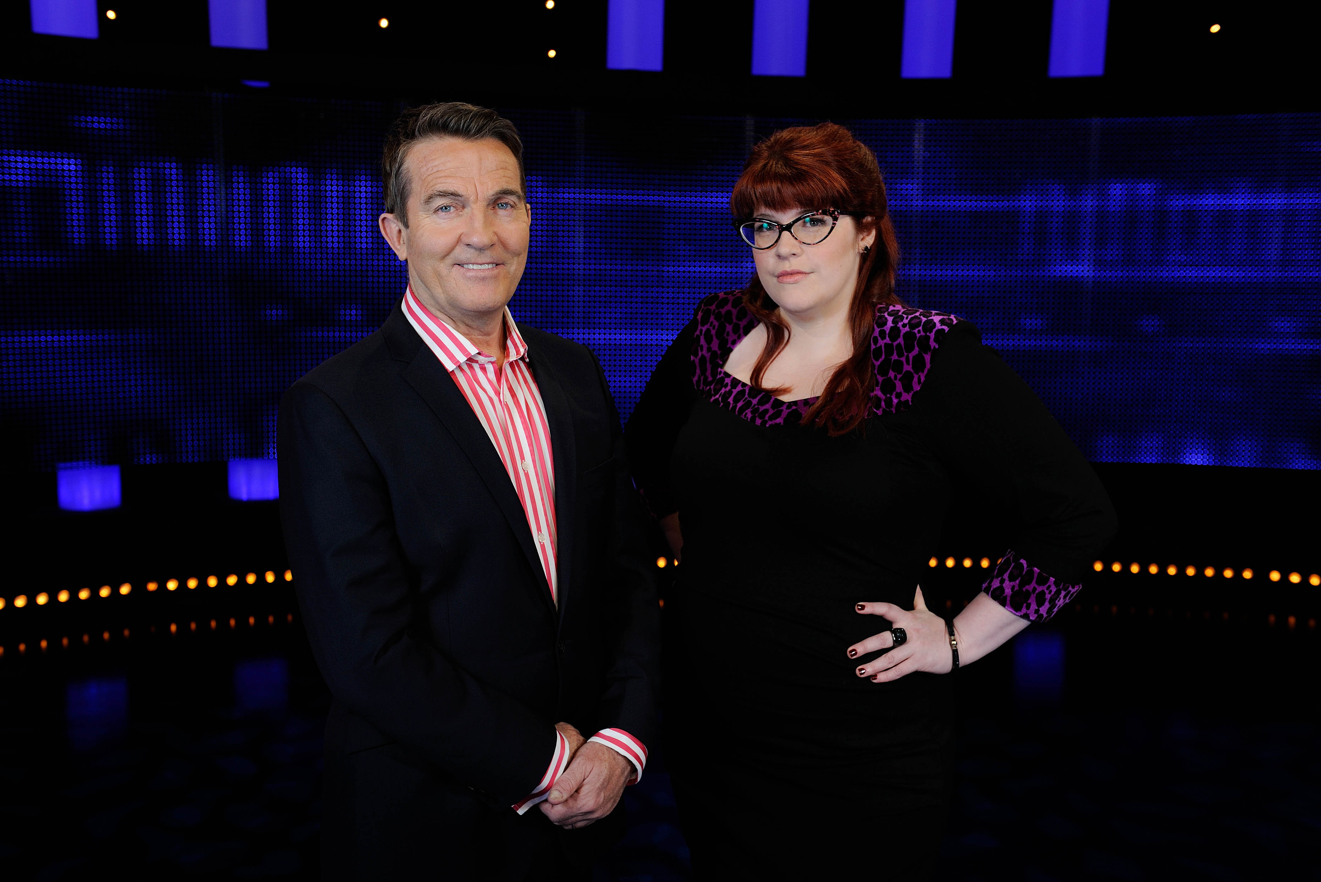 From ITV Studios THE CHASE Weekdays from 1st September 2015 on ITV Pictured: Host Bradley Walsh with new Chaser Jenny Ryan ITV DaytimeÕs The Chase, returns after a summer break with a brand new Chaser joining the ultra clever clan. The series - hosted by Bradley Walsh - will see Jenny ÔThe VixenÕ Ryan join Anne ÔThe GovernessÕ Hegerty, Shaun ÔThe Dark DestroyerÕ Wallace, Mark ÔThe BeastÕ Labbett and Paul ÔThe SinnermanÕ Sinha in the hit quiz show. Jenny brings the hot to The GovernessÕ cool and has also earned herself the name of The Bolton Brainiac by Bradley! The Chase isnÕt just a quizÉ itÕs a race, where the players must ensure they stay one step ahead of ÔThe ChaserÕ, a ruthless quiz genius determined to stop them winning at all costs. Stay ahead of ÔThe ChaserÕ and the team of contestants build a cash sum and share the pot. Get caught and they lose the lot. Jenny said: ÒI'm thrilled to be joining the formidable line-up on The Chase! It's a dream job for any quizzer, and I can't wait to see what the contestants make of me - especially when I catch them!Ó Jenny will first appear on the show on Wednesday 2nd September at 5pm on ITV. The Chase series 9 continues after a summer break on Monday 31st August and airs weekdays at 5pm on ITV. © ITV For further information please contact Peter Gray 0207 157 3046 peter.gray@itv.com This photograph is © ITV and can only be reproduced for editorial purposes directly in connection with the programme THE CHASE or ITV. Once made available by the ITV Picture Desk, this photograph can be reproduced once only up until the Transmission date and no reproduction fee will be charged. Any subsequent usage may incur a fee. This photograph must not be syndicated to any other publication or website, or permanently archived, without the express written permission of ITV Picture Desk. Full Terms and conditions are available on the website www.itvpictures.com
