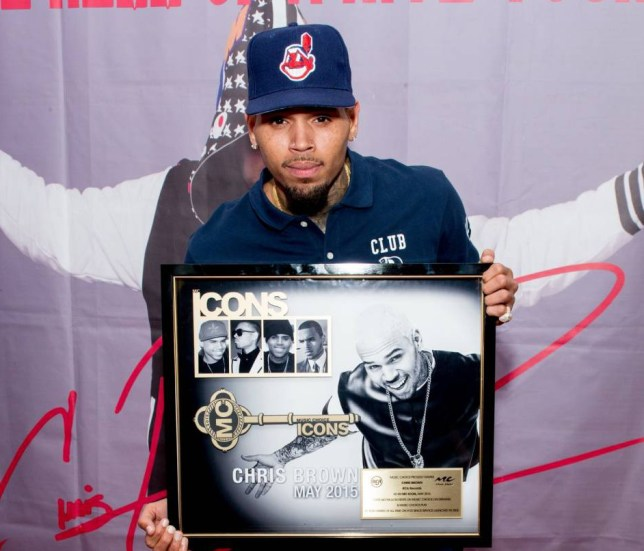 WANTAGH, NY - AUGUST 30: Chris Brown poses with a commemorative plaque celebrating him being named an MC Icon and being the top artist of all time on Music Choice On Demand at Nikon at Jones Beach Theater on August 30, 2015 in Wantagh, New York. This recognition honors his career achievements and the substantial impact he has had on Music Choice fans since his first album in 2005. (Photo by Noam Galai/Getty Images for Music Choice)