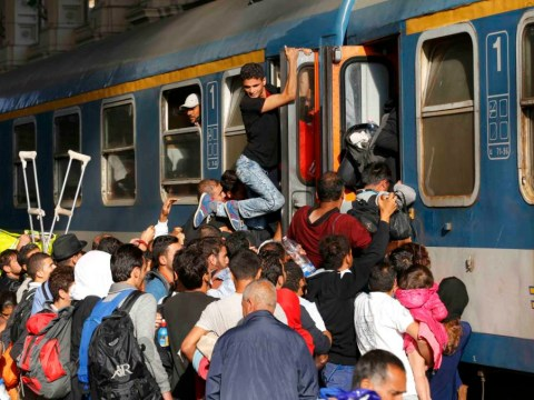 'Utter chaos' as Budapest station reopens to refugees following two-day stand-off