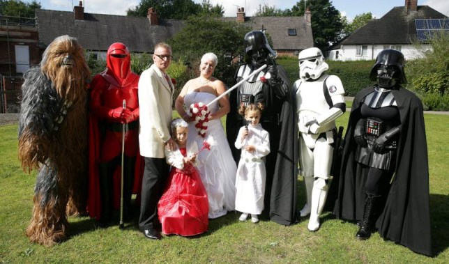 Lee Bowder and Pip Stephenson at their Star Wars themed wedding in Chesterfield. See Ross Parry copy RPYSTAR : The force was strong at Chesterfield Registry Office on Friday when a cast of characters from a galaxy far, far away arrived to celebrate the wedding of two of their own. A stormtrooper stood guard as a wookie, two Darth Vaders, an Imperial Guard and a Princess Leia arrived along with many other guests more traditionally attired. Fulfilling their destiny were Lee Bowder and Pip Stephenson from Selstone, who are both active members of the East Midlands Garrison, a Star Wars ìcosplayî organisation based in Derby. Groom Lee Bowdler, dressed immaculately in a cream jacket and red cravat, said: ìI just thought it would be nice for the area and might put a smile on people's faces.