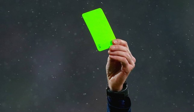 AUGSBURG, GERMANY - FEBRUARY 01: The referee show the Yellow card during the Bundesliga match between FC Augsburg and TSG 1899 Hoffenheim at SGL Arena on February 1, 2015 in Augsburg, Germany. (Photo by Alexander Hassenstein/Bongarts/Getty Images)