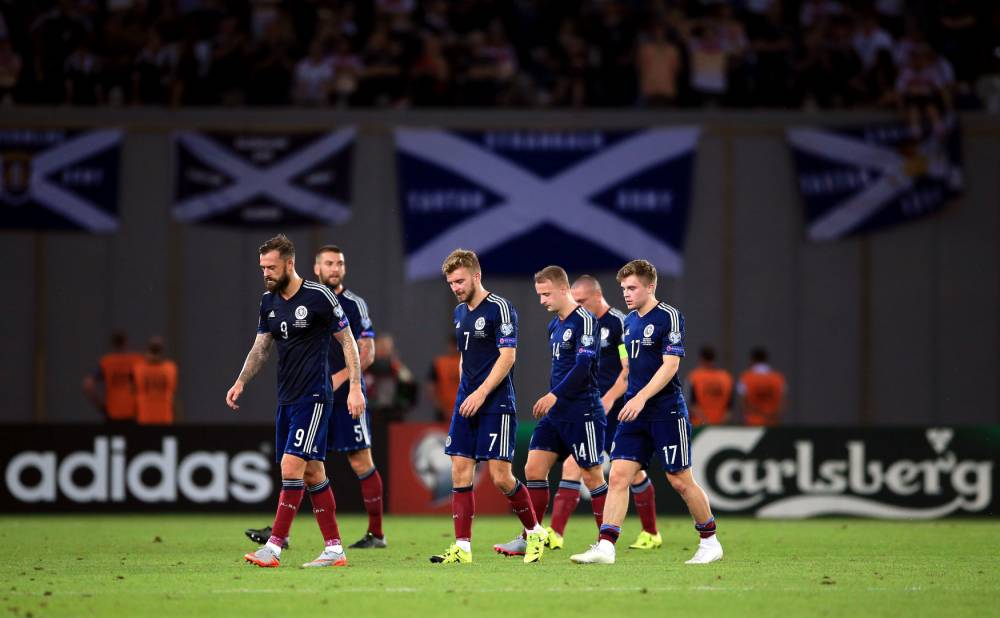 Scotland's players stand dejected after the UEFA European Championship Qualifying match at the Boris Paichadze Dinamo Arena, Tbilisi. Picture date: Friday September 4, 2015. See PA story SOCCER Georgia. Photo credit should read: Nick Potts/PA Wire. RESTRICTIONS: Use subject to restrictions. Editorial use only. Commercial use only with prior written consent of the Scottish FA. Call +44 (0)1158 447447 for further information.