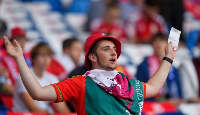 CARDIFF, WALES - SEPTEMBER 06:  A Wales fan enjoys the pre match atmosphere during the UEFA EURO 2016 group B qualifying match between Wales and Israel at Cardiff City Stadium on September 6, 2015 in Cardiff, United Kingdom.  (Photo by Stu Forster/Getty Images)