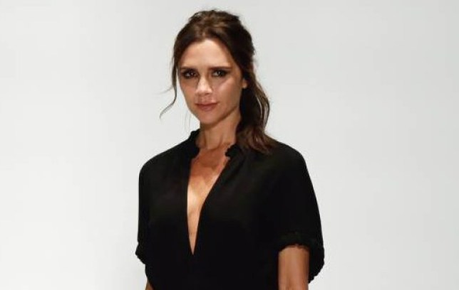 Designer Victoria Beckham appears on stage after her Spring 2016 collection was modeled during Fashion Week in New York, Sunday, Sept. 13, 2015. (AP Photo/Richard Drew)