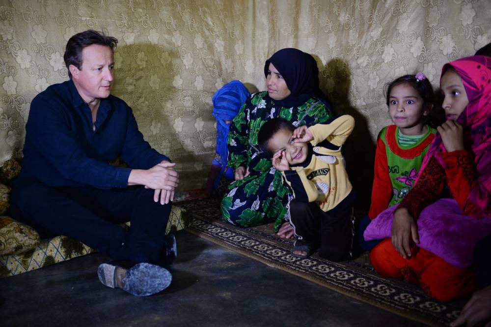 Prime Minister David Cameron meets Syrian refugee families at a tented settlement camp in the Bekaa Valley on the Syrian - Lebanese border. Mr Cameron is in the region to see conditons and meet those who have fled their homes in Syria. PRESS ASSOCIATION Monday September 14 2015. See PA story POLITICS Cameron. Photo credit should read: Stefan Rousseau/PA.