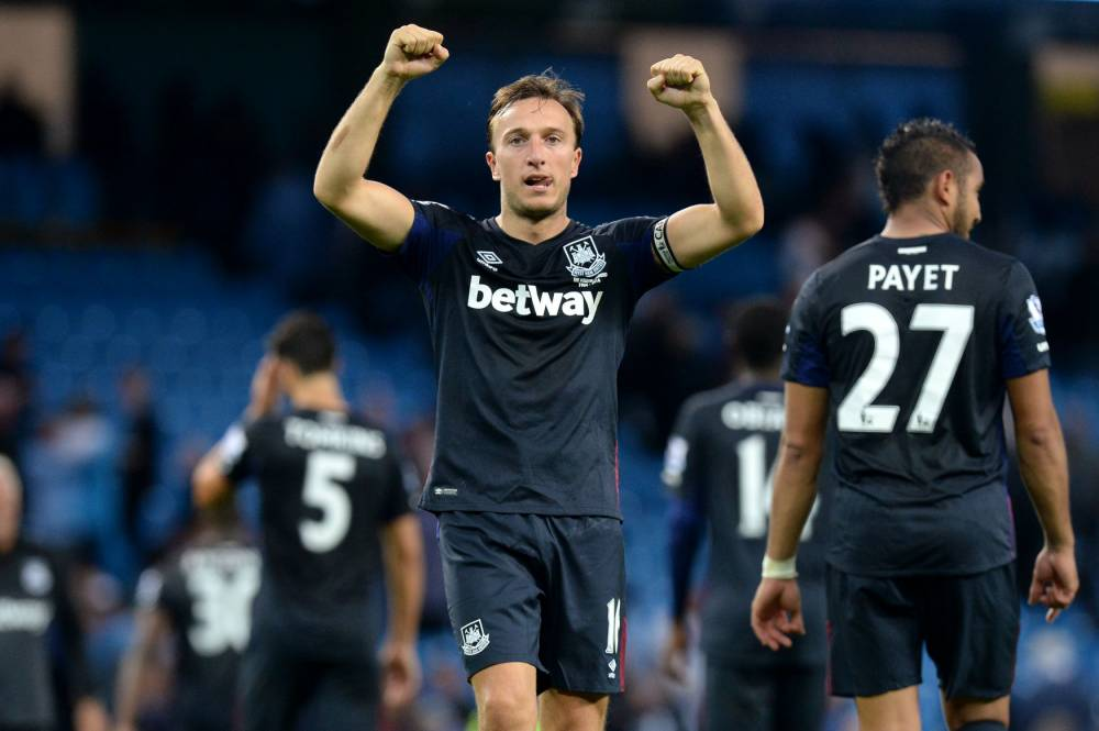 "West Ham United's Mark Noble celebrates after the final whistle during the Barclays Premier League match at the Etihad Stadium, Manchester. PRESS ASSOCIATION Photo. Picture date: Saturday September 19, 2015. See PA story SOCCER Man City. Photo credit should read: Martin Rickett/PA Wire. RESTRICTIONS: EDITORIAL USE ONLY No use with unauthorised audio, video, data, fixture lists, club/league logos or ""live"" services. Online in-match use limited to 45 images, no video emulation. No use in betting, games or single club/league/player publications."