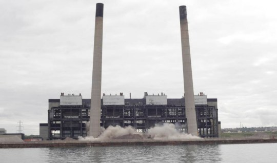 Handout photo issued by ScottishPower of the twin chimney stacks of former Cockenzie power station, in East Lothian, being demolished in a controlled explosion. PRESS ASSOCIATION Photo. Picture date: Saturday September 26, 2015. The 149-metre tall landmarks of Cockenzie Power Station in East Lothian were brought down at midday, with a second explosion destroying the turbine hall immediately afterwards. A boiler house is the last remaining major structure from the power station and will be demolished later this year. See PA story SOCIAL Demolition. Photo credit should read: ScottishPower/PA Wire NOTE TO EDITORS: This handout photo may only be used in for editorial reporting purposes for the contemporaneous illustration of events, things or the people in the image or facts mentioned in the caption. Reuse of the picture may require further permission from the copyright holder.