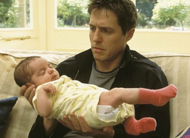 hugh grant holding a baby in about a boy