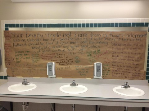 Students cover bathroom mirrors with messages of self acceptance