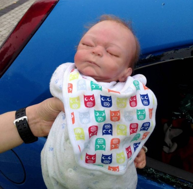 """The doll that police believed was locked in the car. Police smashed their way into a car parked outside a Dudley hospital fearing a sick baby was locked inside - only to find the """"infant"""" was a doll. See NTI story NTIDOLL. The baby doll, named Ryan, had been left by its owner, 10-year-old Janaih Rattray, lying in a blanket on the front passenger seat of her sister Delesia's Vauxhall Corsa on the car park at Russells Hall Hospital while they visited their mother. Janaih's family say they believe that observing the doll's hands, which they claim were visible in the car, it should have been possible for the officers to realise it was not real. But police insist it was """"extremely life-like"""", with only the top of its head exposed, and the officers who smashed their way in genuinely believed it was a baby, alone and critically ill, in a locked car outside the hospital, which has a maternity unit."""