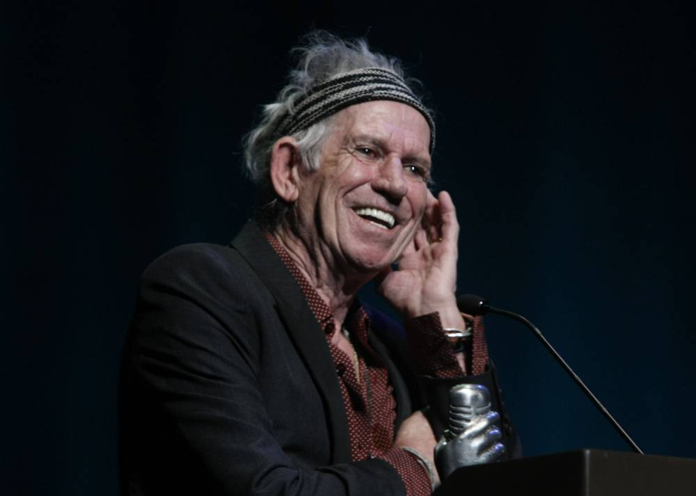 Rolling Stones guitarist Keith Richards inductes Elvis's guitarist Scotty Moore, not pictured, during the Memphis Music Hall of Fame Induction Ceremony, Saturday, Oct. 17, 2015, in Memphis, Tenn. Moore was not present for the event. (AP Photo/Karen Pulfer Focht)