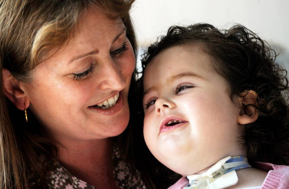FILE PICTURE - Cerys Edwards when aged 3, with her mum Tracey. Cerys Edwards, the little girl left with catastrophic injuries after a speeding driver hit her parentsí car in 2006, has died in hospital. See NTI story NTICERYS. Her devastated dad Gareth has now paid tribute to the bravery of his nine-year-old daughter - whose smile ìwould melt the hearts of anyoneî. The tragic youngster had just celebrated her first birthday when her family car was hit head-on by millionaireís son Antonio Boparan, in November 2006. The massive impact left Cerys paralysed, unable to speak, permanently dependent on a ventilator and requiring round-the-clock care. Cerys, who would have been 10 next month, died on Saturday evening at Birmingham Childrenís Hospital. Over the years she had endured dozens of major operations. Builder Gareth, from Sutton Coldfield, described her as a ìhappy little girl who will be missed by all who knew her.î