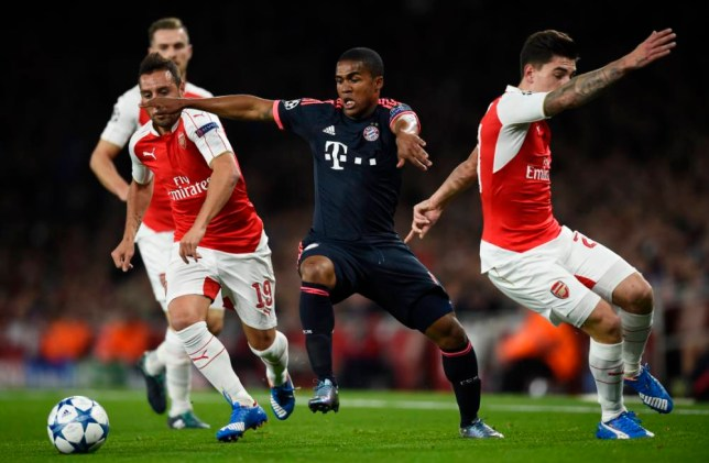 Football - Arsenal v Bayern Munich - UEFA Champions League Group Stage - Group F - Emirates Stadium, London, England - 20/10/15 Bayern Munich's Douglas Costa in action with Arsenal's Hector Bellerin and Santi Cazorla Reuters / Dylan Martinez Livepic EDITORIAL USE ONLY.