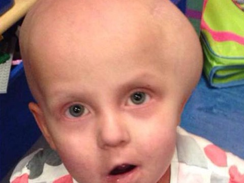 Toddler refused pioneering treatment for brain tumour by NHS back in school after operation in US