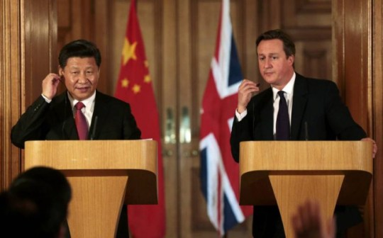 British Prime Minister David Cameron (R) and Chinese President Xi Jinping host a joint news conference following their meeting at 10 Downing Street in central London, on October 21, 2015. China vowed to finance one third of Britain's first nuclear power plant in decades in a project led by French energy giant EDF confirmed on the second day of President Xi Jinping's state visit. AFP PHOTO / SUZANNE PLUNKETT / POOLSUZANNE PLUNKETT/AFP/Getty Images