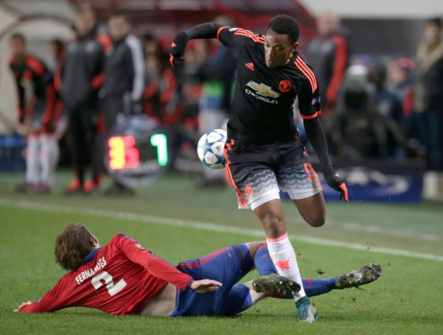 Manchester United's Anthony Martial, right, is challenged by CSKA's Mario Fernandes, left, during Champions League Group B soccer match between CSKA Moscow and Manchester United at the Arena Khimki stadium in Moscow, Russia, on Wednesday, Oct. 21, 2015. (AP Photo/Pavel Golovkin)